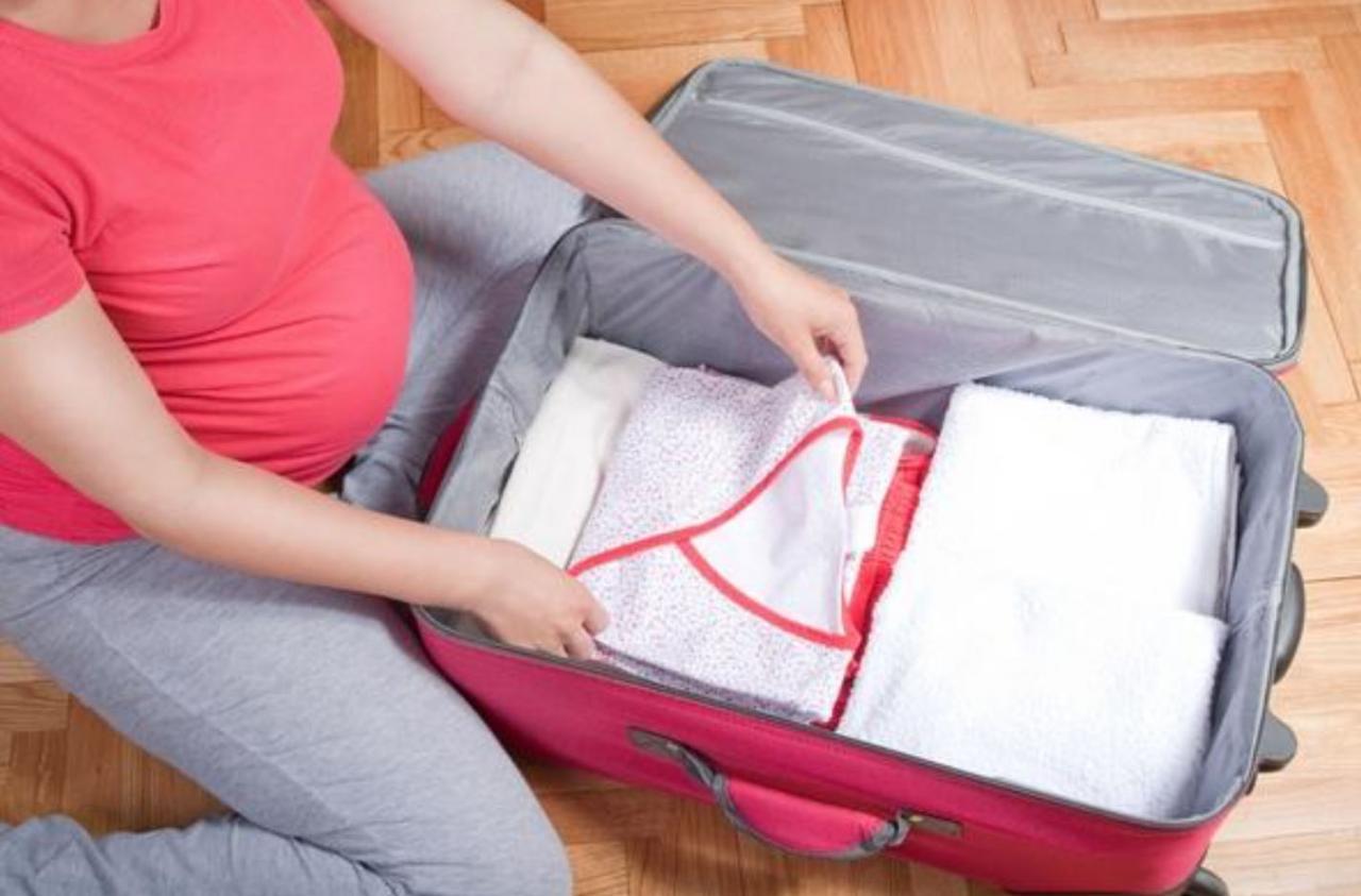 بالصور تحضير شنطة الولادة , اغراض الام والجنين معا 11453 2