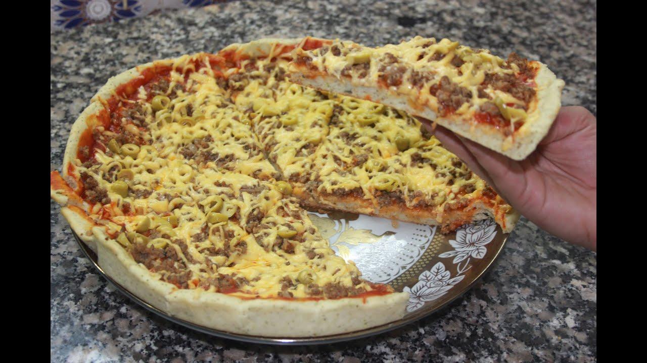 صورة كيفية تحضير البيتزا , الوصفة الاحترافية لعمل البيتزا